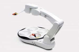 Bras robotisé OBI : solutions ergonomiques pour l'aide au repas